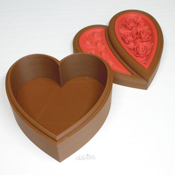 Sirds formas rotu kārbiņa ar rožu elementiem.
